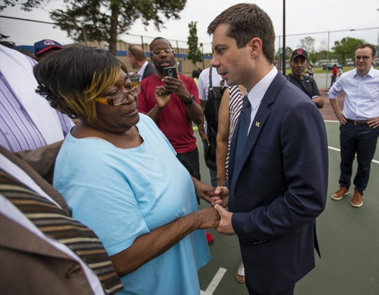 South Bend Mayor and Democratic presidential candidate Pete Buttigieg shares a moment with Shirley Newbill, mother of Eric Logan, during a gun violence memorial Wednesday at the Martin Luther King Jr. Recreation Center in South Bend.