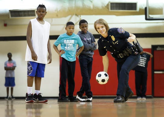 Major Catherine Cummings, the first female major of the investigations division for the IMPD, visits and plays with the GREAT Campers at the JTV Hill Center.