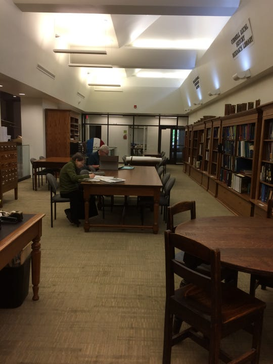 Researchers in the Tompkins Center for History and Culture's new Cornell Local History Research Library.