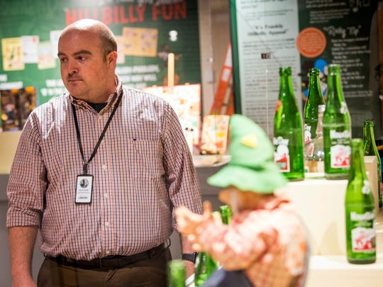 Curator Adam Alfrey shows items that will be on display in an exhibit dedicated to Mountain Dew and its origins in Tennessee at the Museum of East Tennessee History in downtown Knoxville on Monday, June 24, 2019.