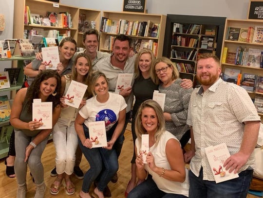 Friends of Laura Mansfield gathered to support the author at her book launch at Union Ave Books on May 30, 2019.
