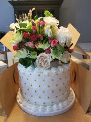"""""""Wedding cake"""" flavored cake, floral decorated with buttercream icing and edible pearls, baked for a baby shower in Karns in May."""