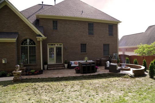 "Knoxville's Jason and Sarah Gulley received a backyard makeover from TV show ""Today's Homeowner."" This is an after shot of their backyard with a new patio and other features."
