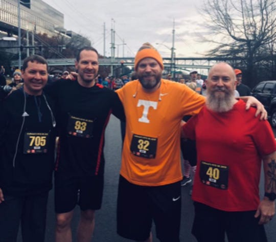 Friends Brett Ellison, Dan Lyle, Tony Pointer and Michael Cline at the New Year's 5K in downtown Knoxville, Jan. 1, 2018.