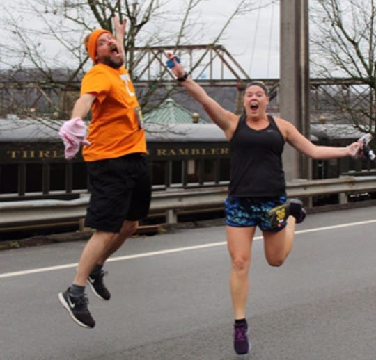 Tony Pointer and his sister Lori McCown run the New Year's 5K in downtown Knoxville, Jan. 1, 2018.