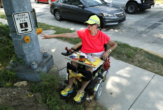 On a 2013 tour of West Lafayette streets,, Jan Myers demonstrated Tuesday how a pedestrian-activated signal button was installed incorrectly  so someone in a power chair couldn't reach it at Salisbury and Wiggins streets.