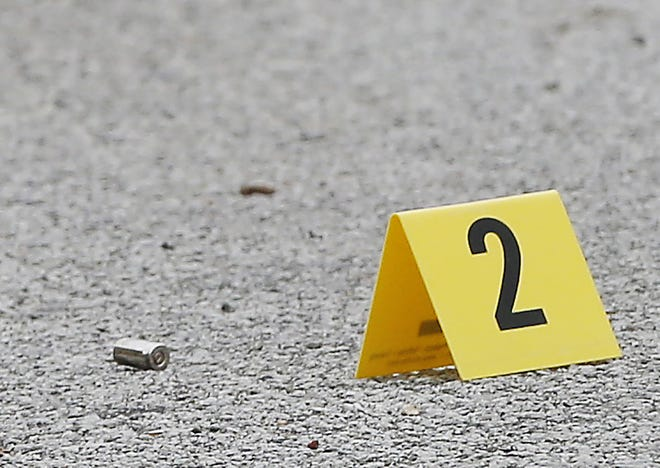Someone shot four rounds into a parked car Friday night.