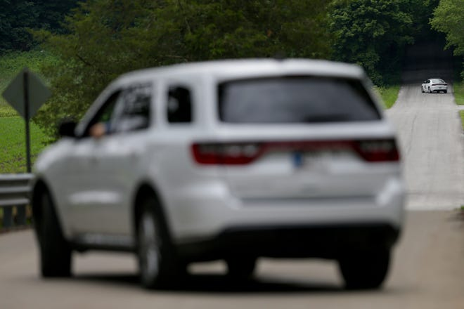 Tippecanoe County Sheriff's department vehicles block access to the 700 block of S 775 E as they continue to search for suspected kidnapper and sexual assaulter Paul A. Etter, 55, Monday, June 24, 2019 in Lafayette. Etter has evaded capture since Saturday.