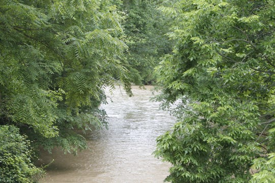 Thick undergrowth and the rising Wildcat Creek made the search for 55-year-old Paul A. Etter difficult. Police suspect Etter abducted a woman Saturday and sexually assaulted her. Police from several agencies have been searching for Etter since Saturday night.