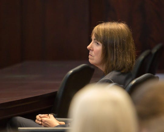 Suspended Judge Theresa Brennan listens to arguments from her attorney Dennis Kolenda before the Michigan Supreme Court Wednesday, June 19, 2019.