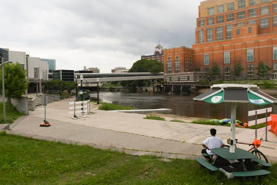 Santos Granado of Lansing took a break Monday from his ride along the River Trail in downtown Lansing. At that time, he wasn't aware of the Ingham County Health Department's no contact order for the river.