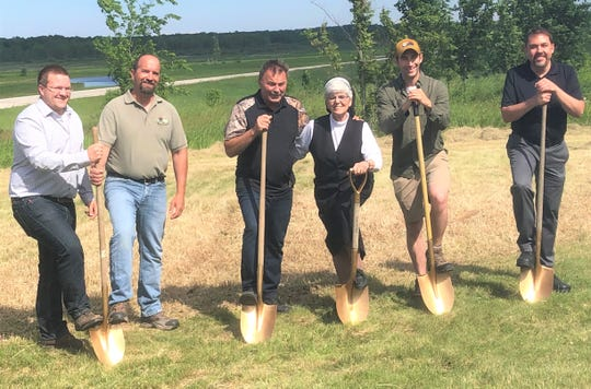 Conservation Education, Inc., broke ground for the new Nature Center at Collins Marsh on June 20. Pictured from left: Collins Marsh Nature Center naturalist James Downy, DNR wildlife biologist Steve Easterly, Dave's Home Building of Reedsville, contractor for the new building, Dave Isajiw, Silver Lake College naturalist Sister Lorita Gaffney, former Collins Marsh naturalist Adam Van De Ven, and Manitowoc County Fish and Game Protective Association President Dan Dufek.
