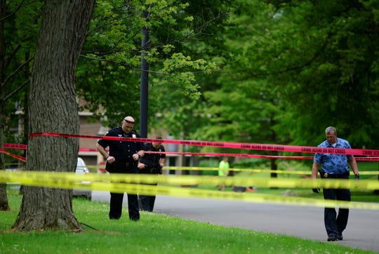 Police canvassed the area of Brinkerhoff Avenue Monday after two men were injured in a shooting.