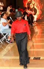 """Kashiim Gibbs, 14, walks the """"Rocking My Extra Chromosome Fashion Show"""" in Los Angeles. He will also walk the runway when the show comes to Memphis. Renadda Wiggins said people with Down syndrome have the same abilities as other people have, and the fashion show helps show that."""