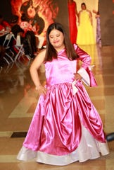 """Stephanie Gonzalez, 14, walks the """"Rocking My Extra Chromosome Fashion Show"""" in Los Angeles. Renadda Wiggins, founder of the fashion show, began The Art of Runway, a modeling agency for people with Down syndrome."""