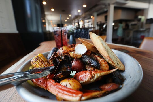 A crab boil at Saltwater Crab includes shrimp, mussels, clams, sausage, corn and potatoes.