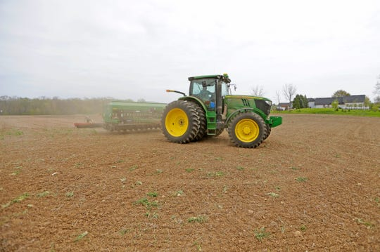 Patrick Lemke, with Lemke Seed Farm in Mequon, works on planing soybeans in his brother's field near the corner of Granville Road and Donges Bay Rd. in Mequon on Monday, May 9, 2016. With warmer weather, and before it rains again, farmers are in the field in full force with spring planting.