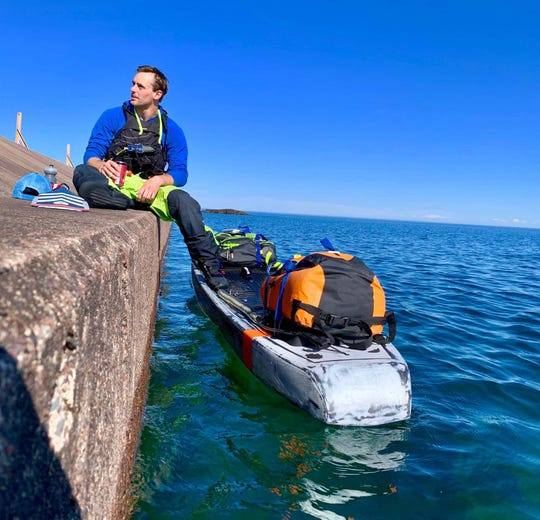 Jared Munch of Holcombe, Wisconsin, rests during his attempt to travel across Lake Superior up to James Bay on the Arctic Ocean.