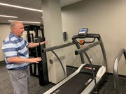 Chris Becker, CEO of the YMCA of Greater Waukesha County, explains the difference in this cardio treadmill at the New Berlin Wellness Center. It has cushioned belt that's meant to reduce the stress on joints for older adults who use it.