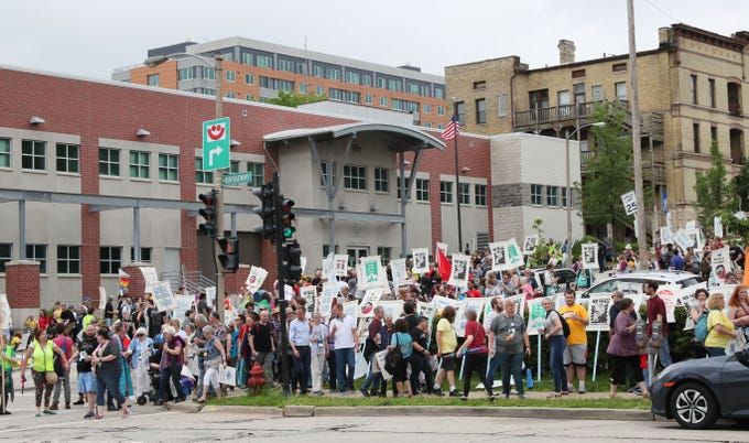 Protesters march around the U.S. Immigration and Customs Enforcement building at 310 E. Knapp St. on Monday after coming from the Wisconsin Center. Hundreds of members from United Church of Christ's general synod and other local church groups protested deportations of undocumented immigrants by ICE.