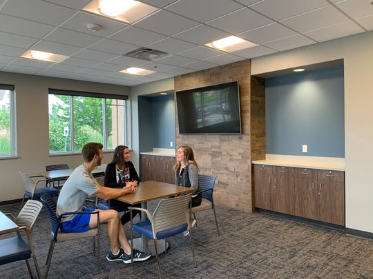Staff members (from left) Ryan Buenning, Stefany Begue and Amanda Albert relax in the lounge just inside the entryway to the YMCA Wellness Center in New Berlin. The lounge is intended as a comfortable place for members to socialize, which YMCA officials say is particularly important for many older adults.