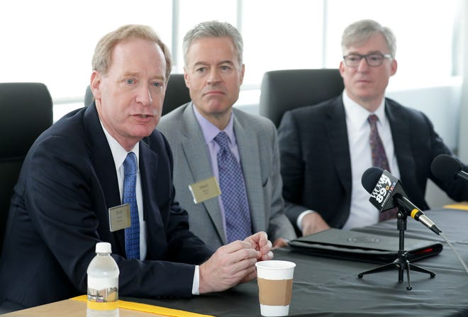 Microsoft president Brad Smith (from left) and University of Wisconsin-Milwaukee chancellor Mark Mone, with Rockwell Automation CEO Blake Moret, announced a $1.25 million gift to support the school's investment in smart technology Monday at the Lubar Entrepreneurship Center on the UWM campus.