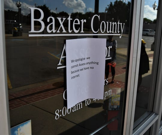 A sign posted on the entrance to the Baxter County Assessor's Office notes that the offices does not have any internet service Monday afternoon.