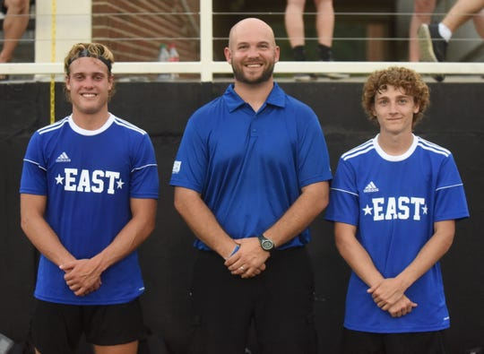 Mountain Home boys' soccer coach Nathan Criner (middle), and Bombers Talyn Benton (left) and Koby Weber played for the East team in the AHSCA All-Star games over the weekend in Conway.