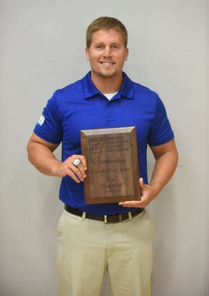Izard County's Kyle McCandlis served as an assistant coach for the East team at the AHSCA All-Star games Saturday, and the state champion coach also was named the Outstanding Boys' Basketball Coach of the Year.