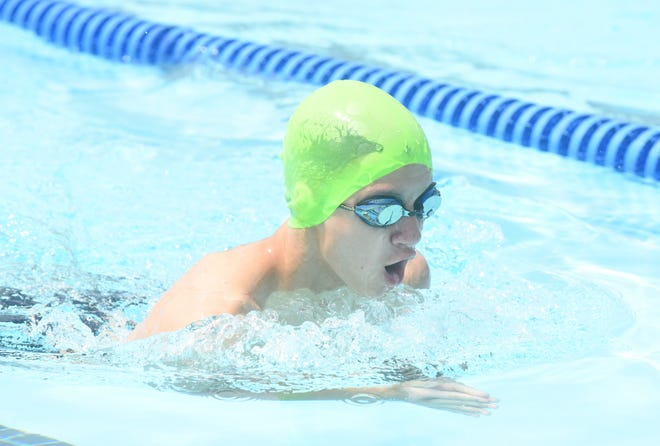 Mountain Home's Brandon Belicek competes in a breaststroke event during a recent home swim meet at Cooper Park.