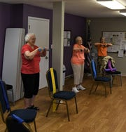 Members of the women's exercise group work out Thursday morning at the Mruk Family Education Center on Aging. The center offers both men's and women's exercise classes.