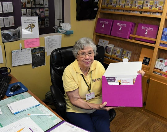"""Mruk Family Education Center on Aging volunteer Barbara Buffon holds one the center's Alzheimer's disease """"tool boxes"""" available to caregivers. The Mruk Center will hold an open house Friday afternoon in celebration of its 10th anniversary."""