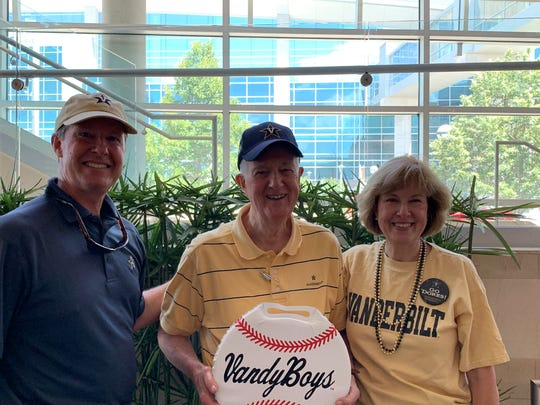 Vanderbilt fan Stephen Cragon Sr., center, poses with son Stephen Cragon Jr., and daughter Carol Cragon Sims at the Commodores' send-off party before their College World Series game Monday in Omaha, Neb.