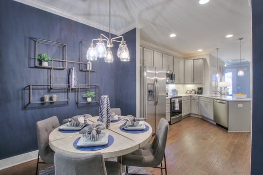 The kitchen and breakfast area of a Goodall Homes townhome in Durham Farms.