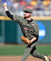 Vanderbilt pitcher Drake Fellows (66) throws a pitch against Michigan in the 2019 NCAA Men's College World Series Finals at TD Ameritrade Park  Monday, June 24, 2019, in Omaha, Neb.