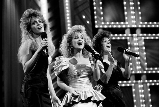 "Co-hosts Irlene, left, Barbara and Louise Mandrell open the 23rd Music City News Awards show at the Grand Ole Opry on June 5, 1989, with ""The Life Blood of Country Music."" The tribute to fans was written by Louise Mandrell's husband, R.C. Bannon."