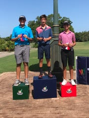 Aydin Khan Bridgers, center, of Naples won the Boys 14-15 Division at the Drive, Chip and Putt local qualifier at Foxfire Golf & Country Club  on Monday.