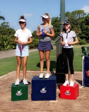 Eliza Kodak, center, of Naples won the Girls 14-15 Division at the Drive, Chip and Putt local qualifier at Foxfire Golf & Country Club on Monday.