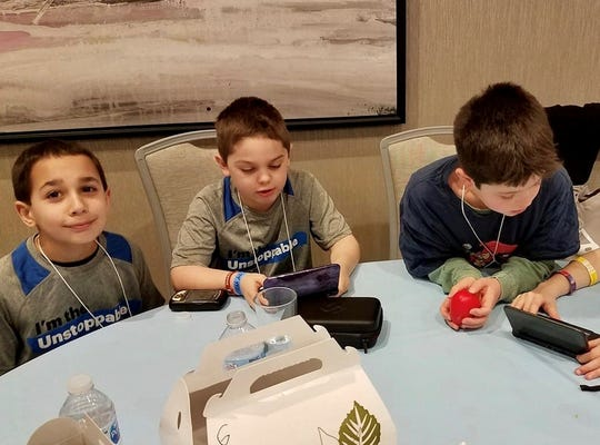 "Buddies Zach Durso, 9, of Maywood; Russell Ballou, 8, of Nutley; and Beckett Sutton, 9, of Bedminster met each other in JDRF's ""Blue Crew"" peer to peer program."
