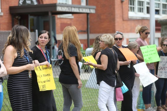 Pre-kindergarten teacher,Tatiana Alabee, and others are shown outside Prospect Park School 1.  Faculty and students were voicing their concern over the fact that Security Resource Officer (SRO), Robert Hennessy has not been asked to come back to the school next year.  Monday June 24, 2019