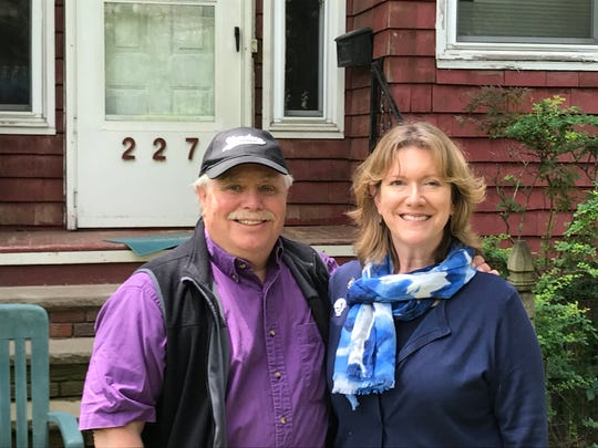 Carolyn Timbie ( R )with her husband at  the house on Van Houten Avenue in Passaic where her grandmother grew up.