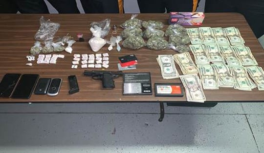 Drugs, money and guns police seized from Gary Cabrera during a traffic stop.