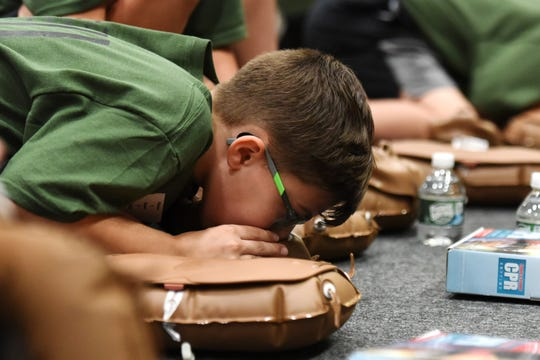 The Pascack Valley Jr. Police Academy receive CPR training at Westwood Regional High School on June 24, 2019. Tyler Mara 10, of Westwood, practices CPR.