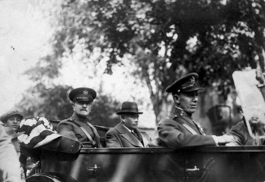 Gen. John J. Pershing and Passaic School Board President Robert Dix Benson, (backseat) and Lt. George Marshall (front seat), who eventually named Secretary of State, dedicate Passaic's cenotaph on Memorial Day 1924.