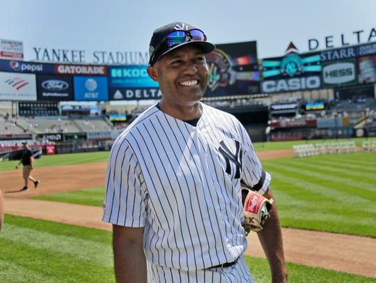 Former New York Yankee Mariano Rivera greets people on the field during Old Timer's Day at Yankee Stadium, Sunday, June 23, 2019, in New York. (AP Photo/Seth Wenig)