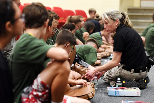 The Pascack Valley Jr. Police Academy receive CPR training at Westwood Regional High School on June 24, 2019. Washington Twp. Detective Heather Castronova helps with the CPR training.