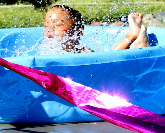 A kiddie pool can provide temporary relief from the summer heat in Deming, NM.