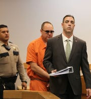 Attorney C.J. McElhinney leads his client Corban Serna to the courtroom, Monday June 24, 2019, for a pre-trial detention hearing.