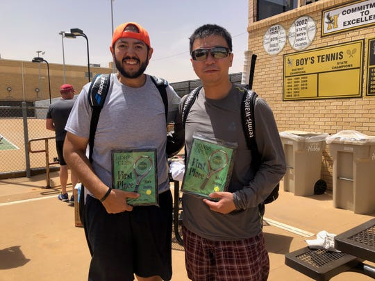 Donnie Rodriguez Jr., left, and Yaxi Zhao, right, hold their first place plaques after defeating Brady Spears of Hobbs and Toby Spears of Lovington in the Hobbs Open doubles championship on June 8. The Carlsbad duo won, 6-3, 6-1. The Hobbs Open was a USTA Intermediate/Advanced level tournament.