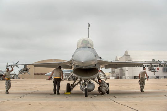 Airmen from the 314th Aircraft Maintenance Unit ensure weapons are loaded to a 314th Fighter Squadron F-16 Fighting Falcon, prior to take off June 4, on Marine Corps Air Station Miramar, Calif. The 314th FS F-16 pilots conducted dissimiliar combat air training alongside F/A-18 Hornets from the Marine Fighter Attack Squadron 314.